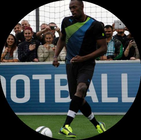 usain bolt plays football